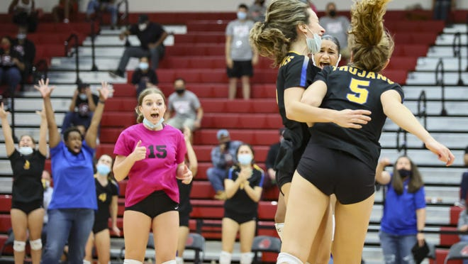 Anderson's volleyball team celebrates its five-set playoff victory over Weiss Nov. 19 at Weiss High School. Anderson advanced to the second round of the Class 5A playoffs.