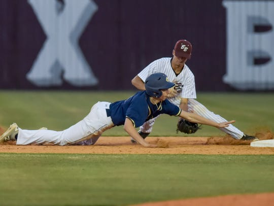 Tigers shortstop Cole Mouton makes the tag to get the