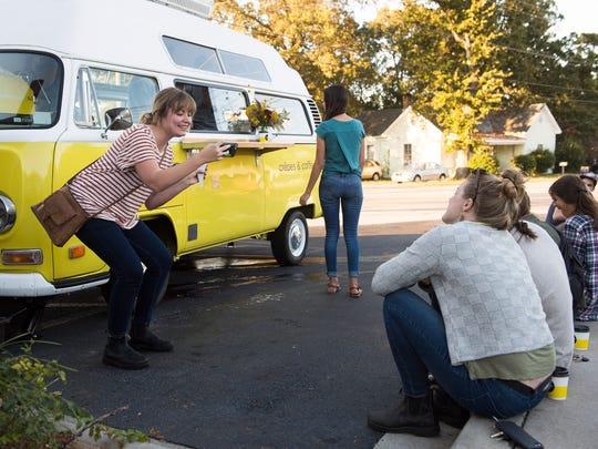 Carissa Engle takes photos of friends at the Tandem Creperie and Coffeehouse van in Travelers Rest on Tuesday, Oct. 4, 2017.