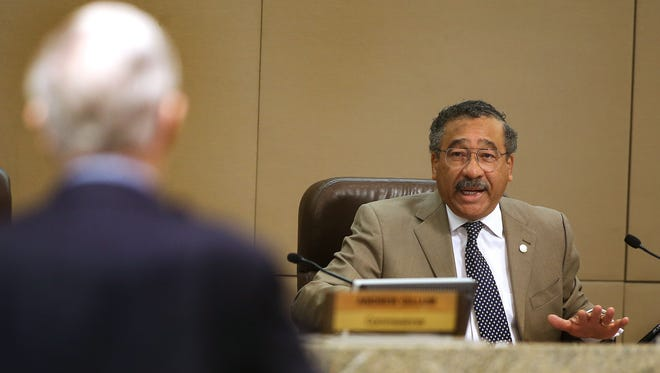 Mayor John Marks speaks to Sandy D'Alemberte as the Tallahassee city commissioners met on Wednesday to get public input and discuss whether or not to place an amendment to include new ethics and campaign-finance provisions in the city charter for the Nov. 4 election.