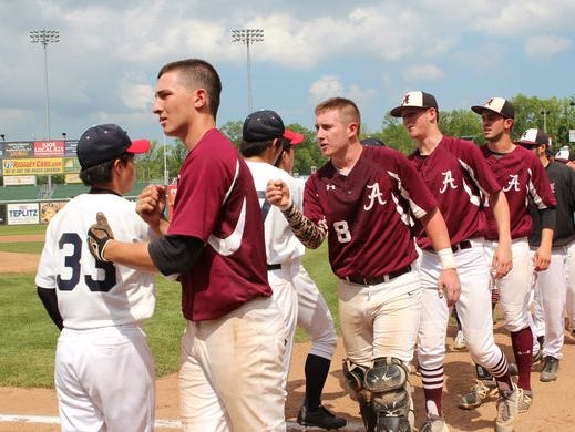 The Albertus Magnus Falcons Baseball greet the Keio Unicorns after the Falcons walk-in 3-2 victory over the Keio Unicorns at the end of a 14 inning game in the Class B sectional final held Provident Park in Pomona on Saturday, May 30, 2015.