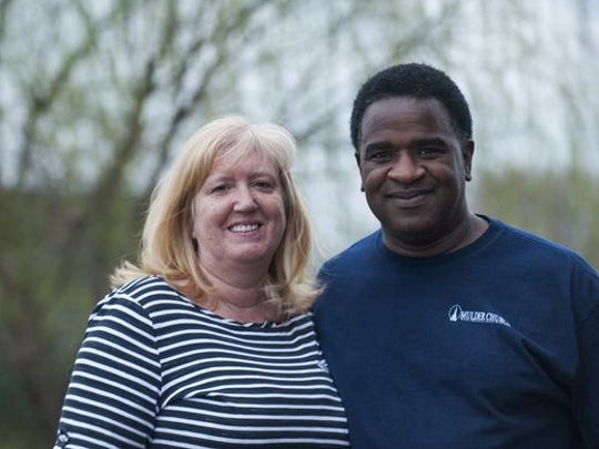 Daryl Moore, right, and his wife Alicyn, left.