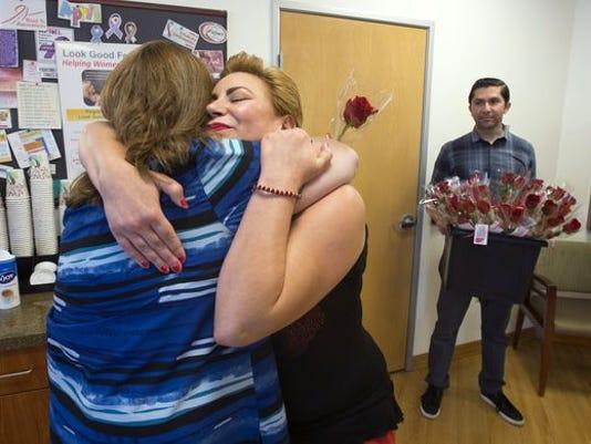 Cancer survivor shares red roses on Red Thursday