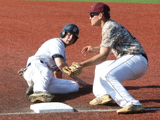 Archbishop Stepinac's Jack Ryan gets safely back to first ahead of the throw to Iona Prep's Andrew Militie during their baseball game at Stepinac in White Plains, April 27, 2016.