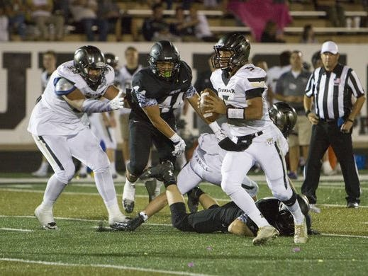 Penei Sewell (left) during a Desert Hills football game vs. Pine View in 2015