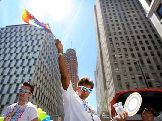 Detroiters celebrate in the Motor City Pride Parade on the same day that a gunman killed more than 50 people at a gay night club in Orlando, Fla.