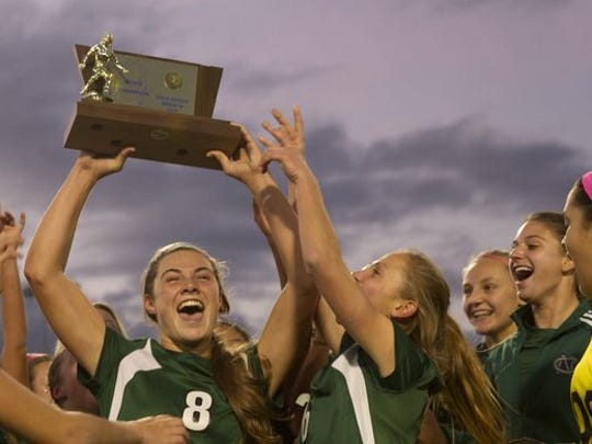 Colts Neck's Amanda Visco waves the championship trophy at fans in the stand after Colts Neck defeated Northern Highlands 1-0. Colt Necks Girls Soccer vs Northern Highlands in NJSIAA State Group III Championship at Kean University on November 21, 2015 in Union, NJ.  Pe