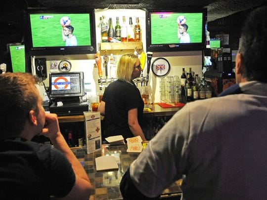 """Fleet Street Pub in Printers Alley allows smoking, although not until after lunchtime. """"I don't want the fact we allow smoking to put off people who want to come in and eat,"""" said owner Ian Wrigley."""