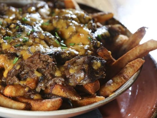 The menu at Germantown Craft House will feature favorites from the restaurant's Crescent Hill location. Pictured here, the poutine served at Crescent Hill Craft House.