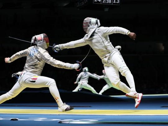 Daryl Homer, right, a Salesian High School graduate, competes against Matyas Szabo of Germany in the men's sabre individual quarterfinal at Carioca Arena 3 during the Rio 2016 Summer Olympic Games.  Homer won the silver medal.