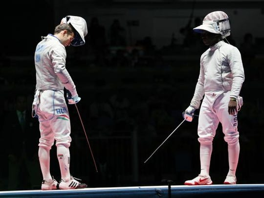 Daryl Homer, right, Salesian High School graduate, and Aron Szilagyi of Hungary prepare for their men's sabre individual gold medal bout at Carioca Arena 3 during the Rio 2016 Summer Olympic Games.  Szilagyi defeated Homer to win the gold, and Homer won the silver medal.