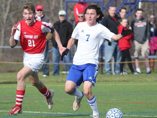 Craig MacDonald (right) dribbles the ball as Pearl River beat Tappan Zee, 3-0 in the Section 1 Class A boys final at Arlington High School, Oct. 31, 2015.