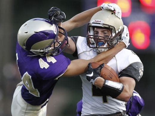 Clarkstown South's Kyle Samuels (4) is tackled by Clarkstown North defensive back Brian Fuller (44) in the first half of their football game at Clarkstown North High School in New City on Friday, September 02, 2016. Clarkstown South won 14-13 taking the supervisors trophy.
