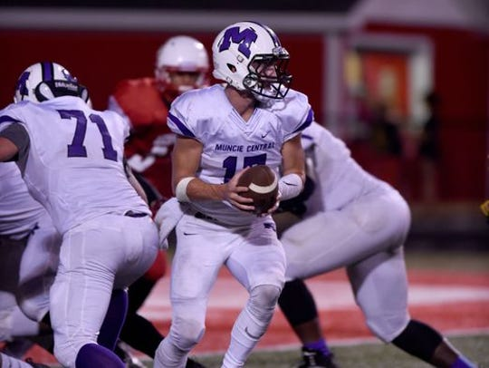Muncie Central's Trenton Hatfield looks to hand off