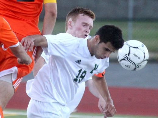 Yorktown's Enzo Sangiacomo heads the ball during a game with Mamaroneck at Yorktown Sept. 12, 2016. Yorktown won 4-2.