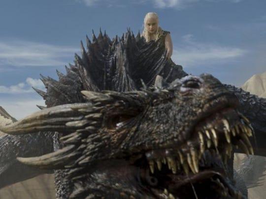 "Daenerys Targaryen climbs on top of Drogon in ""Battle of the Bastards,"" episode 9 of Game of Thrones' season 6."