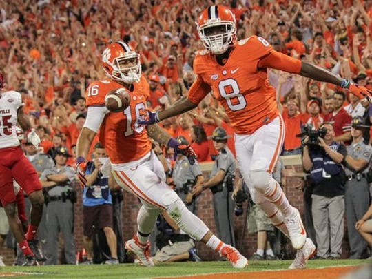 Clemson celebrated a thrilling victory against Louisville on Saturday night