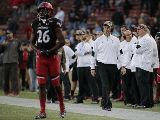 University of Cincinnati football coach Tommy Tuberville walks the sideline during the fourth quarter of Saturday's 20-3 loss to BYU. Tuberville exchanged heated words with a heckler after the game.
