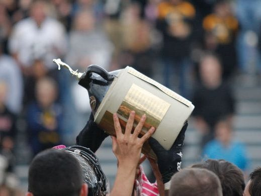 Nanuet is show hoisting the Little Brown Jug in 2014. The Golden Knights beat Pearl River 20-14 in overtime on Nov. 5, 2016 to retain the Jug.