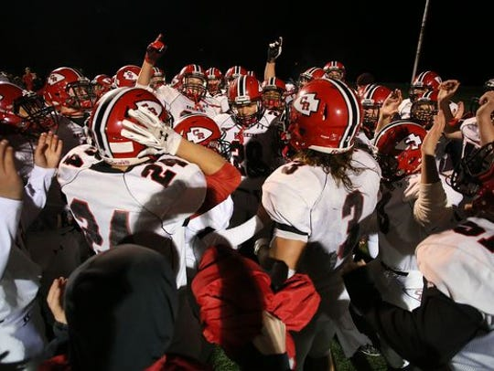 The Coshocton football team celebrates after the win