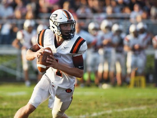 Ridgewood quarterback Jhett Slusser rolls out against