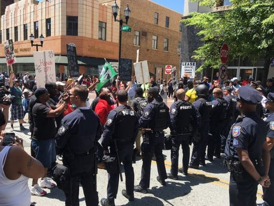 "Protesters face off against police at a march for Jeremy ""Bam"" McDole in Wilmington."