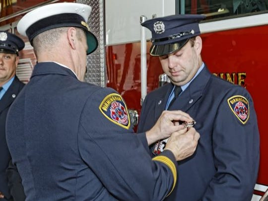 A photograph of Mike McIntyre when he was sworn in as a Birmingham firefighter in June 2015.