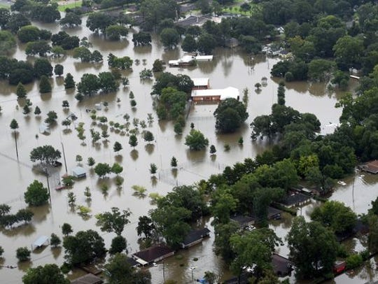 An aerial photograph shows flood damage caused by heavy