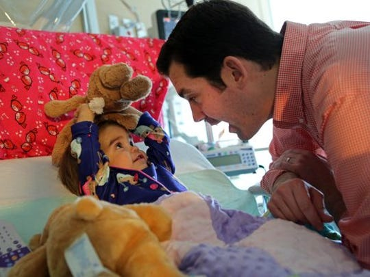 """Susan """"Piper"""" Lee, 19 months, plays with her father, Chris, while recovering from a kidney transplant at Nemours/Alfred I. duPont Hospital for Children."""