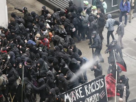 Police are shown using pepper spray on protesters after Donald Trump's inauguration as president on Friday, Jan. 20, 2017.
