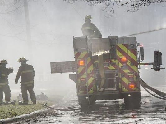 636246710491642506-High-winds-firefighters.jpg