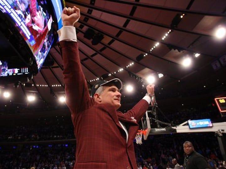 USC coach Frank Martin celebrates the Gamecocks victory against Florida