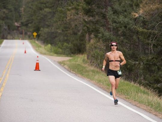 James Lanciaux of Littleton ran by himself for most of the way to win Sunday's Colorado Marathon.