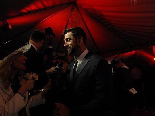 Green Bay Packers quarterback Aaron Rodgers talks to media on the red carpet at The Barnstable-Brown Gala Derby Eve.