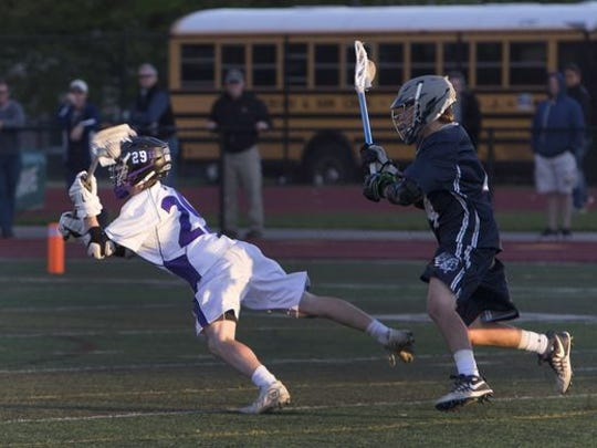 Rumson-Fair Haven's Alex Werner takes a diving shot against Manasquan in the fourth quarter of the 2016 SCT Final at Long Branch High School