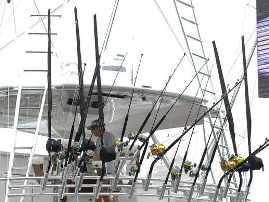 A crew member of the Kallianassa waits for the scales to open at the White Marlin Open on Aug. 9, 2016.