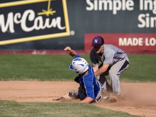 Athens' Jake Stange slides into second base during a WIAA Division 4 sectional final against Niagara. Stange is the lone senior on the Bluejays roster.