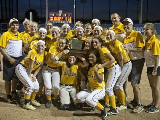 Coach Mike D'Alessandro (at right) and the Watchung Hills HS softball team celebrates the 2016 State Group IV championship
