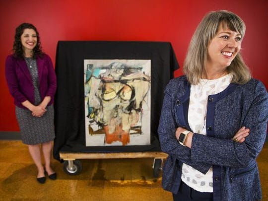 "Olivia Miller, curator of exhibitions for the University of Arizona Museum of Art in Tucson, left, and Meg Hagyard, interim director, are all smiles after the return of ""Woman-Ochre"" to the museum. A similar painting by de Kooning in the same series sold for $137.5 million in 2006."