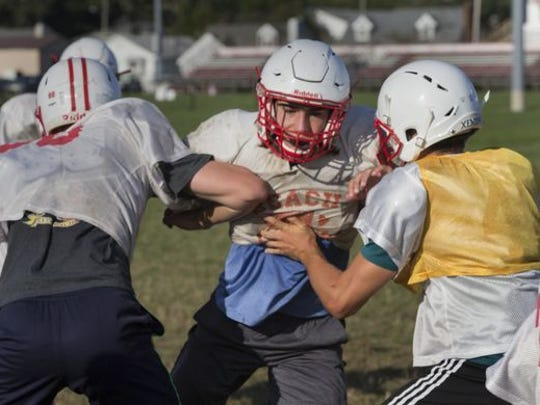 Point Pleasant Beach's Chris Webber looks to break through offensive line during Point Pleasant Beach football practice in preparation for the 2017 Season.
