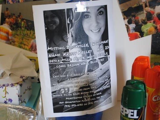 At Studio Bee Community Center in Boonville, Ind., a missing person sign for Kristy Kelley hangs near the front door. The center was the base of operations for search parties.