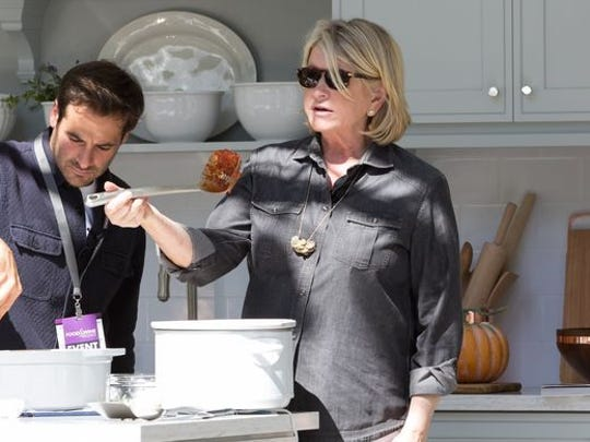 """Martha Stewart talks about utensils during a cooking demonstration in Detroit. She'll share three recipes from her new cookbook, """"Slow Cooker,"""" during the Ventura County Star Food & Wine Experience Oct. 1 in Ventura."""