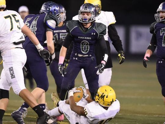 Ryan Madole (54) plays center on offense and linebacker on defense for the Damonte Ranch football team.