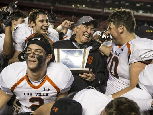 636482719846239284-Somerville-coach-Jeff-Vanderbeek-shares-a-moment-with-Charley-Burkhardt-70-after-CJIII-title-victory-12-2-17---Copy.jpg