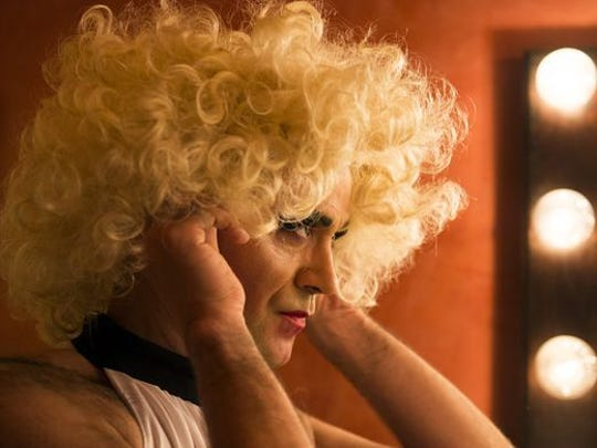 Dito van Reigersberg tries on a wig in his dressing room in March at L'Etage in Philadelphia. Reigersberg performs as Martha as part of the Martha Graham Cracker Cabaret.