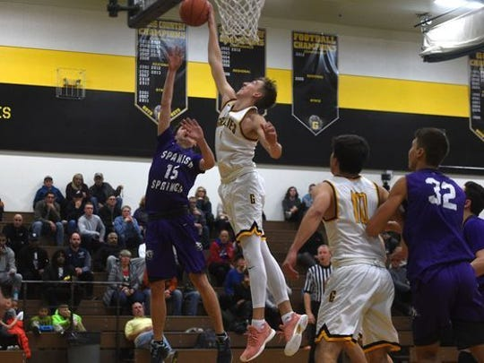 Moses Wood blocks a shot against Spanish Springs earlier this month.