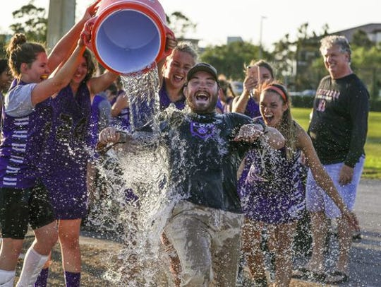 Cypress Lake girls lacrosse coach Tyler White.