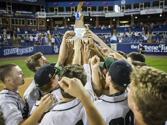 St. Mark's players raise their state championship trophy in 2016.