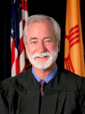 N.M. Justice Charles W. Daniels