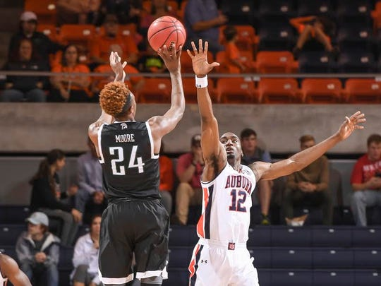 Auburn's LaRon Smith attempts to block a shot against USC-Upstate.